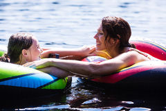 Mother and Daughter floating on lake Royalty Free Stock Photos