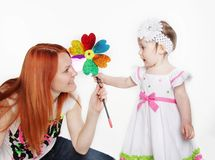 Mother and daughter with flower Stock Photos