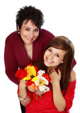 Mother and daughter with flowers Stock Images