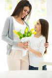 Mother and daughter with flowers Royalty Free Stock Images