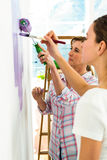 Mother and daughter focused on painting Royalty Free Stock Photos