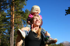 Mother with daughter in forest Stock Photography