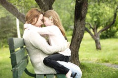 Mother and daughter in forest together Stock Images