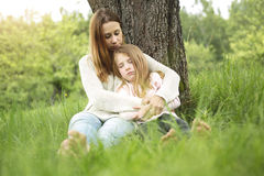 Mother and daughter in forest together Stock Photography