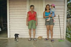 Mother and daughter on front porch in the Valle de Vi�ales, in central Cuba Stock Photography