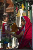 Mother and daughter in front of prayers wheels, Soyambunath temple, Nepal Stock Photos