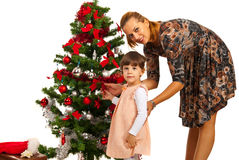 Mother with daughter in front of tree Royalty Free Stock Photography