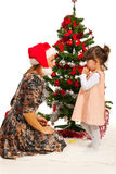 Mother and daughter in front of Xmas tree Stock Images