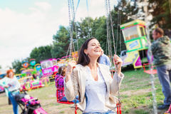 Mother and daughter at fun fair, chain swing ride Stock Photography