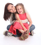 Mother daughter fun and laughter sitting on floor. Family love of mother and daughter having fun embrace with happy laughter sitting on floor. Girl is six years stock images