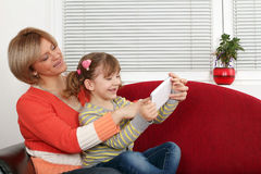 Mother and daughter fun with tablet pc Stock Images