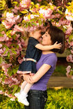 Mother and daughter in garden Royalty Free Stock Photos