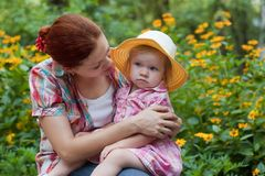 Mother with daughter in the garden Royalty Free Stock Image