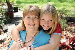Mother & Daughter in Garden Stock Photo
