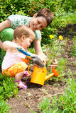 Mother and daughter in garden Stock Images
