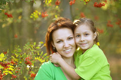 Mother and daughter at garden Stock Photo