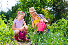 Mother and daughter gardening Stock Images