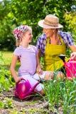 Mother and daughter gardening Stock Photos