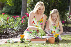 Mother & Daughter Gardening Planting Flowers Stock Image