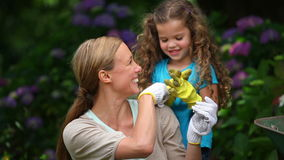 Mother and daughter gardening. And playing together stock video