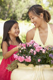 Mother And Daughter Gardening Together Royalty Free Stock Image