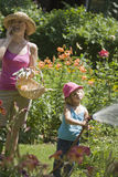Mother and daughter gardening together stock image