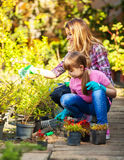 Mother and daughter  gardening together Royalty Free Stock Images
