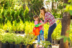 Mother and daughter  gardening together Stock Photo
