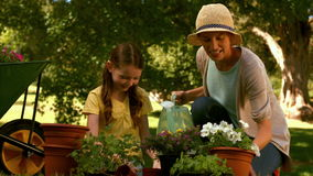 Mother and daughter gardening together stock footage