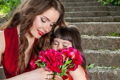 Mother and daughter gentle hug Stock Photography