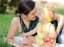 Mother with daughter. Mother and daughter gently play in the Park stock photo