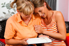 Mother and daughter with gift Stock Photography