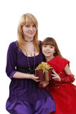 Mother and daughter with gift. Stock Image