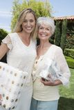 Mother And Daughter With Gift Boxes Stock Photography
