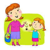Mother and daughter. The daughter giving to mother a sprout Stock Photography