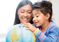 Mother and daughter with globe Royalty Free Stock Image