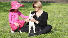 Mother and daughter with goat Royalty Free Stock Photos