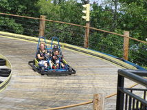 Mother and Daughter in Gocart. Mother and daughter enjoying a fast ride in a speeding go kart Royalty Free Stock Images