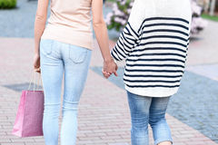 Mother and daughter going in city together Stock Images