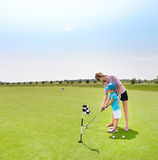 Mother and daughter at the golf course Royalty Free Stock Photos