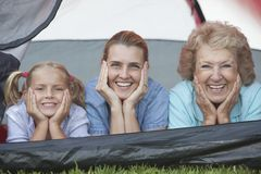 Mother, Daughter And Granddaughter Smiling From Tent Stock Image