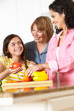 Mother,daughter and grandmother cooking. Mother,daughter and grandmother having fun cooking together Stock Images