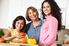 Mother,daughter and grandmother cooking. In kitchen Royalty Free Stock Images