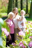 Mother, daughter and grandmother enjoying walk in the park Royalty Free Stock Photos