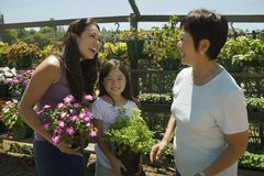 Mother daughter and grandmother shopping in plant nursery Royalty Free Stock Images