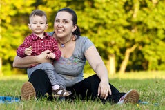 Mother and daughter on grass stock photography