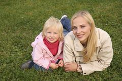 Mother and daughter on grass Royalty Free Stock Images