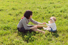 Mother and Daughter in Grass Stock Photos