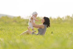 Mother and Daughter in Grass Royalty Free Stock Images