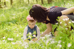 Mother and Daughter in Grass. Mother talking with her cute daughter in grass Royalty Free Stock Images